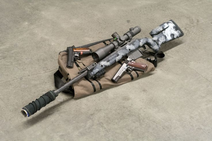 Spartan Precision .300 Win Mag sniper rifle with an Erathr3 Messenger bag and two Colt 1911 handguns.