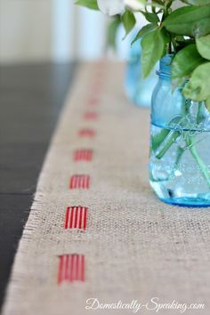 Patriotic Burlap Table Runner - an easy NO SEW runner made perfect for the 4th of July with a red, white and blue ribbon.