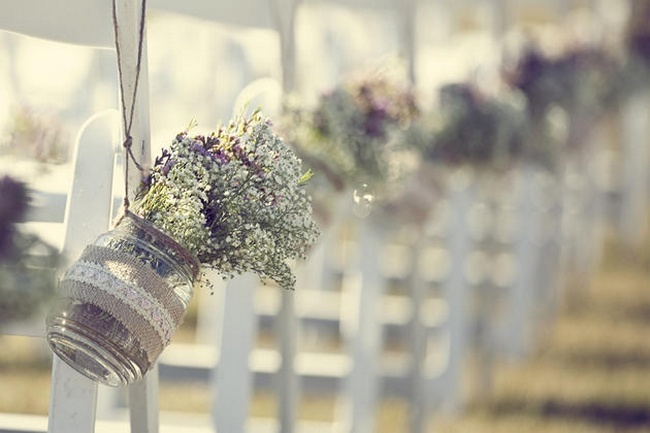 DIY Hanging Mason Jars: The couple created their own DIY hanging mason jars filled with an assortment of flowers, which they hung along their wedding aisle. | Country Chic Burlap & Lace DIY Wedding | Confetti Daydreams