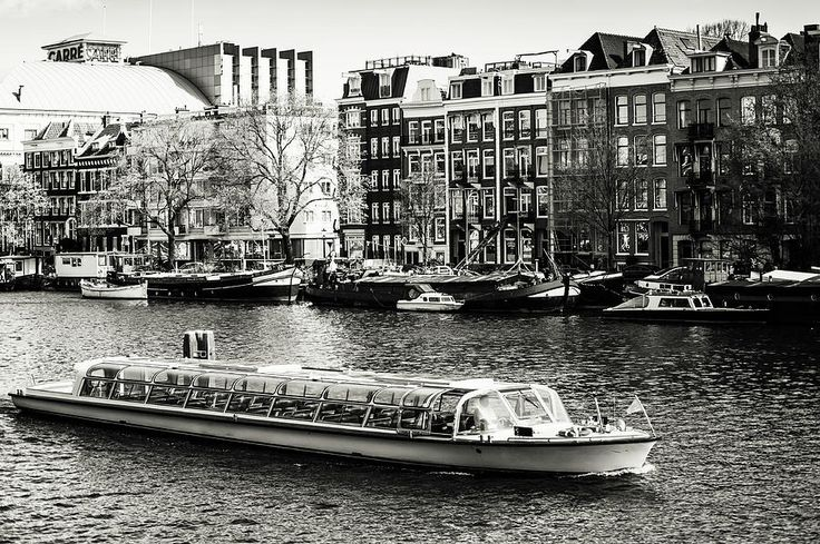 Touristic Boat At Amsterdam Canal. Monochrome by Jenny Rainbow