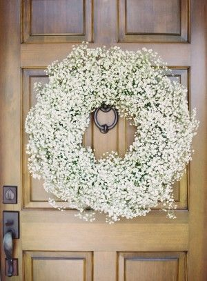 Babys Breath Wreath for the church doors...I'm leaning more towards baby's breath decor!