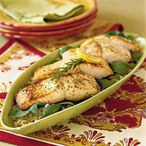 This dish is a highly nutritious choice that has a wonderful citrus flavor from the lemon. Monounsaturated fat from olive oil, Omega-3 fatty acids from salmon, and fiber from brown rice make for a heart-healthy recipe.