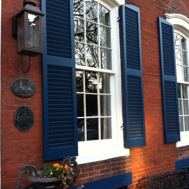 Royal blue shutters on red brick for the home pinterest house spring projects and doors - Red brick house black shutters ...