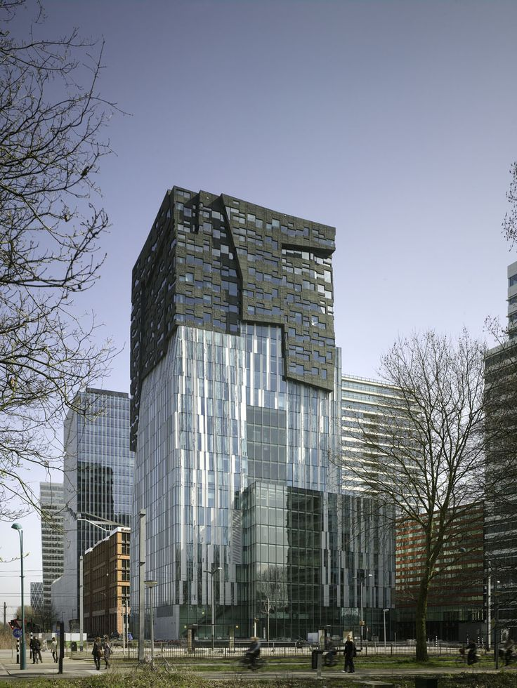 The Erick van Egeraat office tower, also known as The Rock, is part of an expressive high-rise urban development south of Amsterdam, named Zuidas.