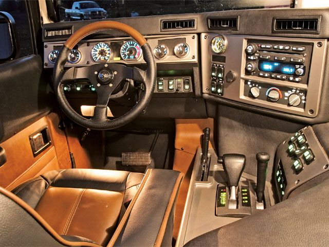 hummer h1.  If this is what they look like  inside, then no thank you.  I want room for my honey to sit next to me, not a bunch of knobs, buttons and levers.
