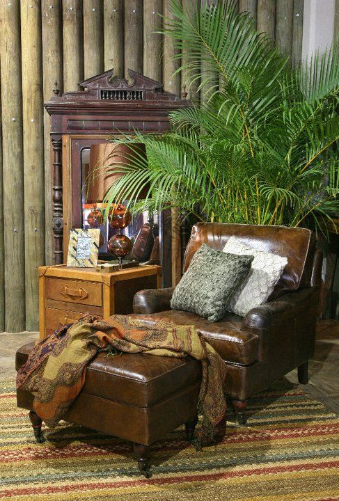 Leather chair and ottoman in tropical, British Colonial decor.