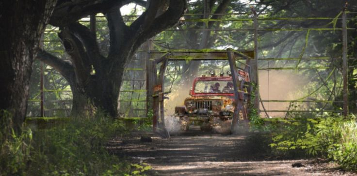 "Concept art of the hot-wired Jurassic Park jeep returning to the Jurassic World enclosure from ""Jurassic World"" (2015)."