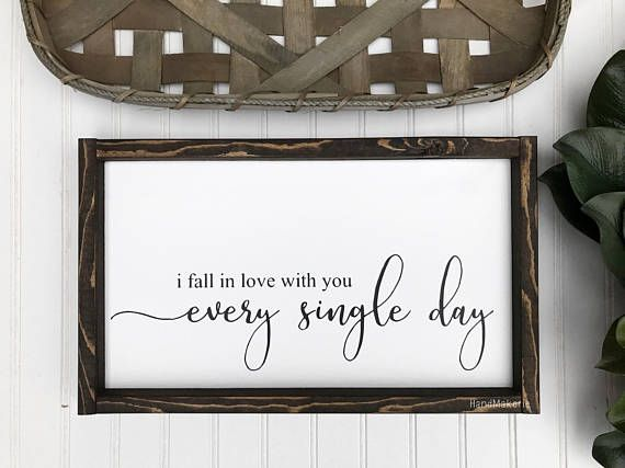 This I fall in love with you every single day painted wood sign is approximately 9H X 16W (without frame) has a painted white background, black painted letters wrapped in a dark stain trim. This particular sign can be a perfect gift for your significant other or spouse. This Sign can be a
