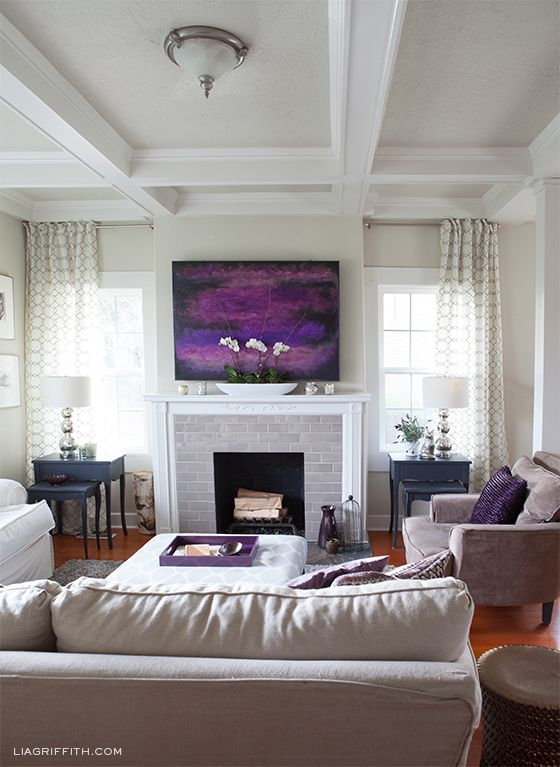 A dramatic painting is the inspiration for this living room's colour scheme.