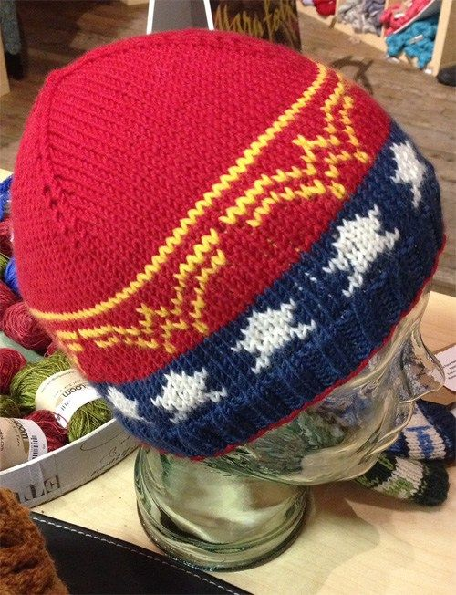 Free knitting pattern for Wonder Woman Beanie Hat -   Christabel Seneque designed this heroic hat with stranded colorwork.
