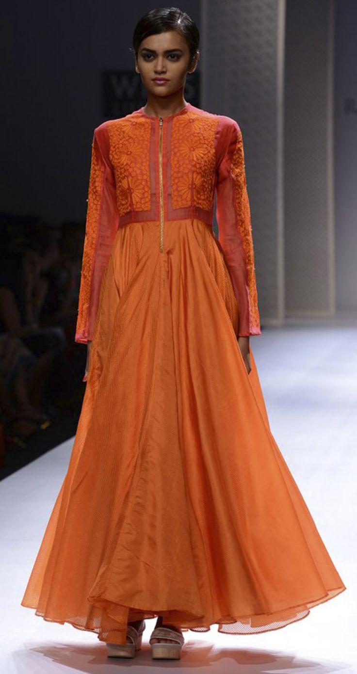 Orange silk long dress by RAHUL MISHRA. http://www.perniaspopupshop.com/wills-fashion-week/rahul-mishra #fashionweek #willslifestyleindiafashionweek
