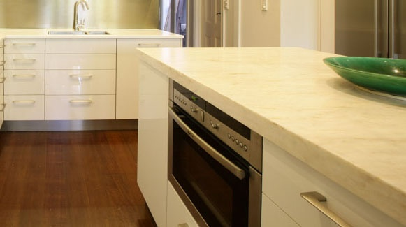 Corian bench top in a kitchen renovation with soft close drawers.