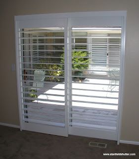 Rodless Shutters With A Clearview Through A Patio Door