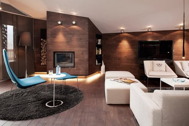 fireplace in wood covered wall