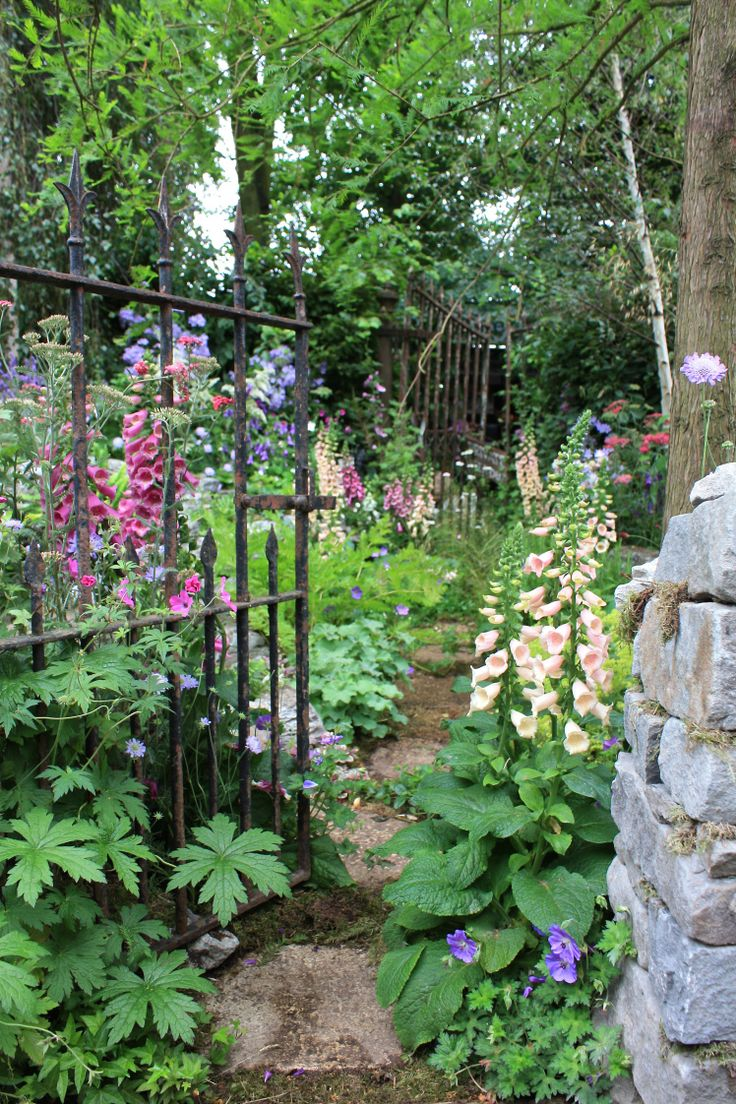 Nature takes hold in and around a ruined folly in this naturalistic garden -Hampton Court flower show