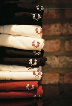 Fred Perry creating a new kind of 'check' with all of these colours (maybe more) and having the logo in every square, being the same colour as it would be on different coloured tshirts