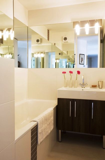 Bathroom - Bright And Simple Bathroom With Wooden Vanity White Vanity Long Mirror White Countertop White Ceiling And White Sink Bright Lamps: Awesome Small Bathroom Design Ideas for Your Comfortable Relaxation Time
