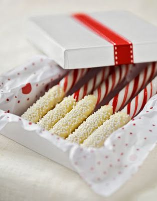 White chocolate dipped candy canes. Another great gift idea for hot chocolate!