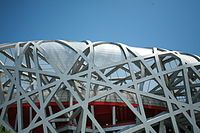 "Beijing National Stadium was a joint venture among architects Jacques Herzog & Pierre de Meuron of Herzog & de Meuron, project architect Stefan Marbach, artist Ai Weiwei, and CADG which was led by chief architect Li Xinggang.""China wanted to have something new for this very important stadium,"" Li stated... to design a stadium that was ""porous"" while also being ""a collective building, a public vessel"", the team studied Chinese ceramics. This line of thought brought the team to the ""nest…"