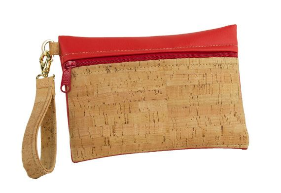 This cork wristlet is the perfect accessory! Cork fabric Eco-friendly and PVC-free faux leather Organic (and fair trade!) cotton lining Red