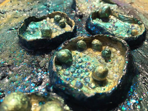 """This abstract wall sculpture is titled """"Night Flowers"""". This piece has thick layers of paint in a variety of colorus, rhinestones and modeling paste."""