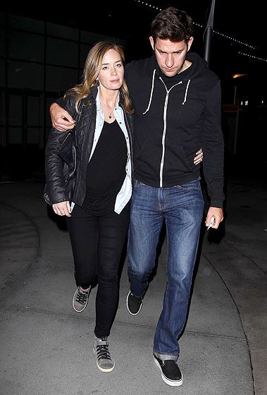 Pregnant Emily Blunt and hubby John Krasinski stay close during a movie date at ArcLight Cinemas.