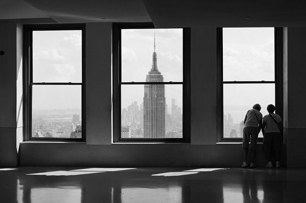 Beautiful photo. Containing/Framing one of the largest buildings on earth inside a window