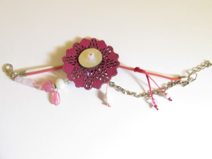 Handmade laser cut leather bracelet (1 pc)  Made with fuchsia leather filigree, leather cords, chain, glass beads and wax cord.