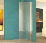 A curved hinged wet room shower screen