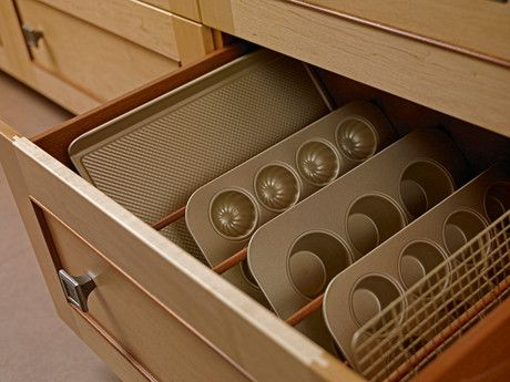 A convenient design of this sleek wood drawer to keep the baking trays.