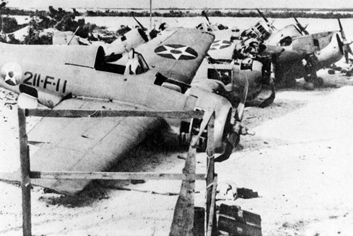 Captured Japanese photograph of the remains of the twelve F4F Wildcats flown by Marine squadron VMF-211 in defense of Wake Island. The plane in the foreground was flown by Henry Hammerin Hank Elrod, the first airman to be awarded the Medal of Honor (posthumous), for his sinking of a Japanese destroyer. Photo Courtesy of the National Archives.