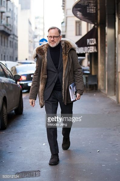 Bruce Pask of Bergdorf Goodman wears a fur-lined Yves Solomon coat over a suit during the Milan Men's Fashion Week Fall/Winter 2016/17 on January 16, 2016 in Milan, Italy.