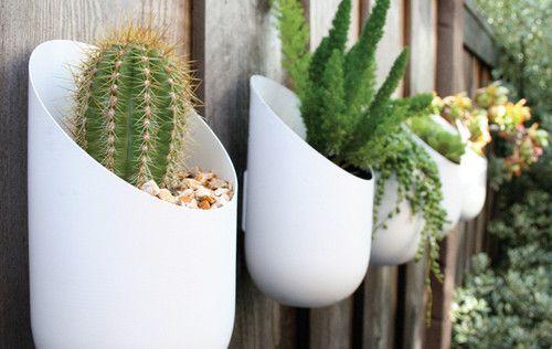 Outdoor wall garden: Gardens Ideas, Fence, Modern Planters, Outdoor Wall, Plants, Sodas Bottle, Hanging Planters, Outdoor Planters, Wall Planters