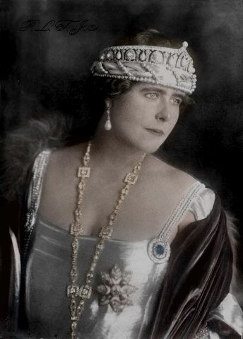Queen Marie of Romania wearing her Cartier tiara and her Cartier necklace with the famous blue sapphire stone.