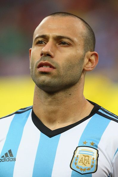 Javier Mascherano Photos Photos - Javier Mascherano of Argentina looks on during the National Anthem prior to the 2014 FIFA World Cup Brazil Semi Final match between the Netherlands and Argentina at Arena de Sao Paulo on July 9, 2014 in Sao Paulo, Brazil. - Netherlands v Argentina