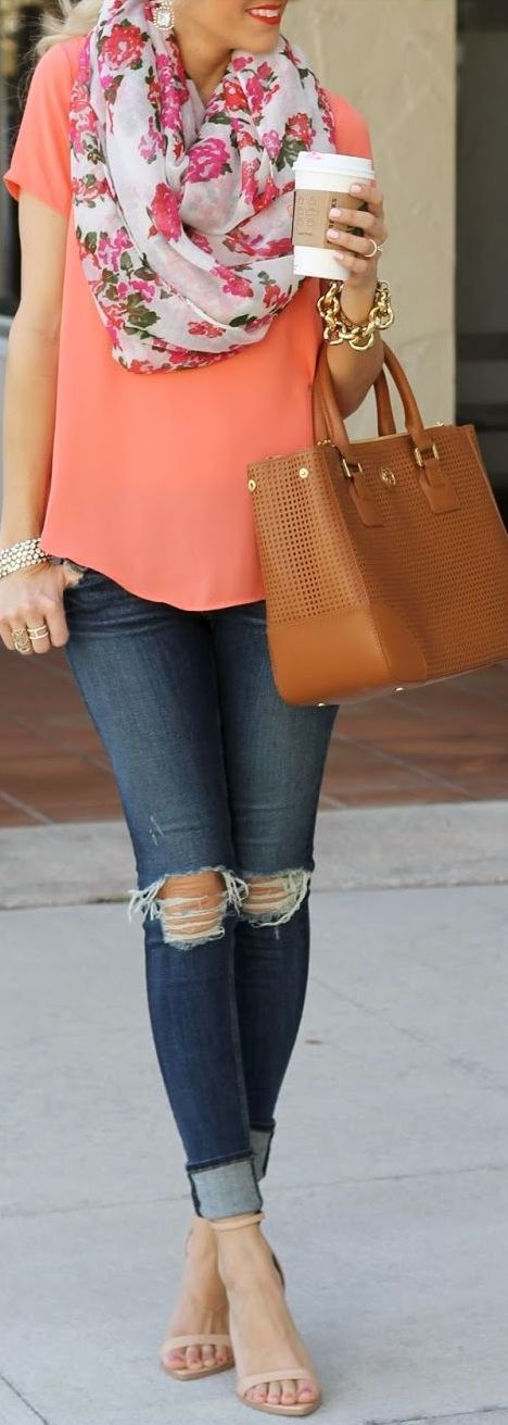 I like the color of the blouse with the flower scarf, the chunky jewelry and the bag. I don't like the torn jeans.
