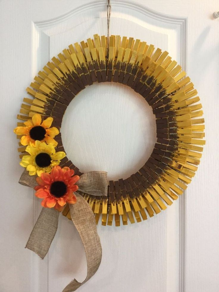 """Easy Clothespin Sunflower Wreath ~~14"""" wire wreath form ~clothespins ~(yellow) Rit Dye (soak clothespins in the Rit Dye for about 4 hours) ~(brown) acrylic paint ~burlap ribbon ~twine ~flowers"""