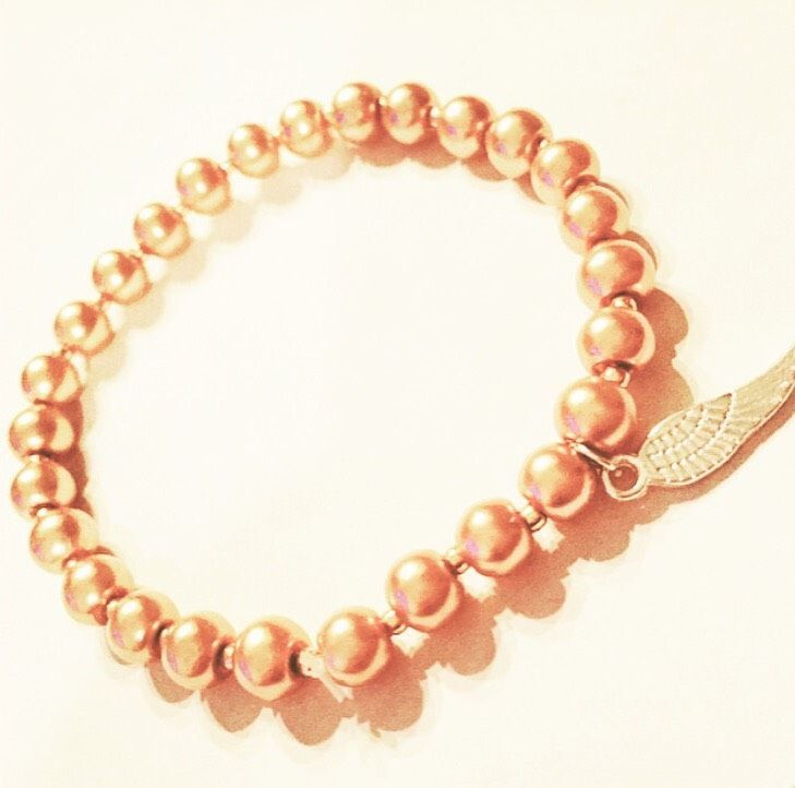 Pearls and A Feather via mBracedesigns. Click on the image to see more!