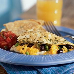 Black beans and cheddar make for a southwestern-inspired hearty omelet filling, but feel free to vary this recipe by using kidney beans or Monterey Jack cheese instead.