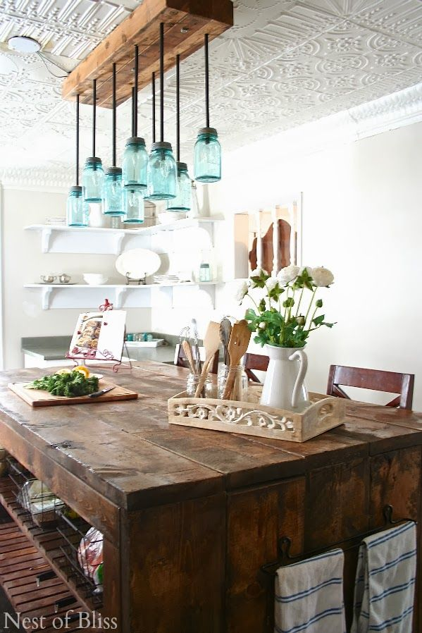 Farmhouse kitchen via Nest of Bliss ... I like the table/island, not the chandelier so much.
