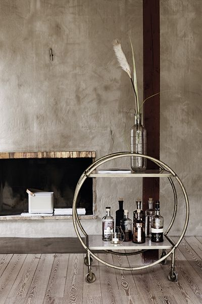 This incredible brass and marble round drinks trolley is part of the SS15 Collection at Rockett St George The dimensions are 76 width x 56 depth x 84