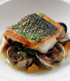 Simon Hulstone's sophisticated sea bass recipe creates a remarkable medley of seaside flavours with cod cheeks, fish sauce and clams.