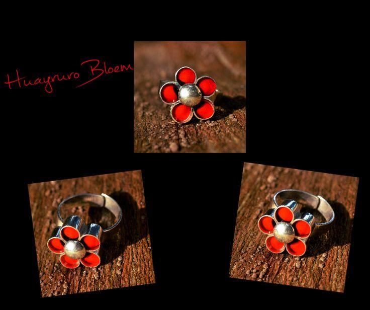 Deze ring is verstelbaar in maat dus past iederen! Leuke ring in de vorm van een bloem met Huayruro zaden. Uniek model! Gratis verzending in Nederland!