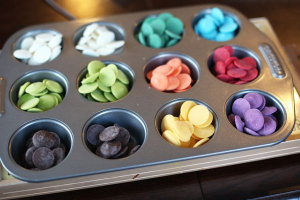How to paint (molds) with chocolate: when using multiple colors, heat each chocolate color (by which I mean candy melts, as you need to temper real chocolate) in a (mini) muffin pan placed on a large warmer. Easy and clever.  From SomewhatSimple.com