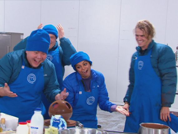 The blue team are the first to have their cake ready and assembled.