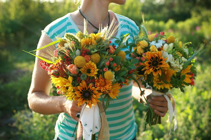 red and yellow summer wedding bouquet of roses, black eyed susans, berries, billy balls and natural grasses | floral design: Floret Flowers
