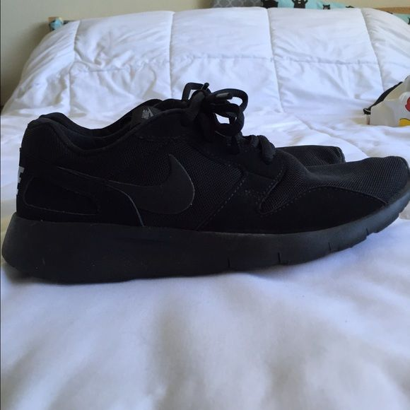 """All black """"Nike"""" shoes All black. Gently used. Size 5 in youth so it can fit a 6.5 in women's. Nike Shoes Sneakers"""