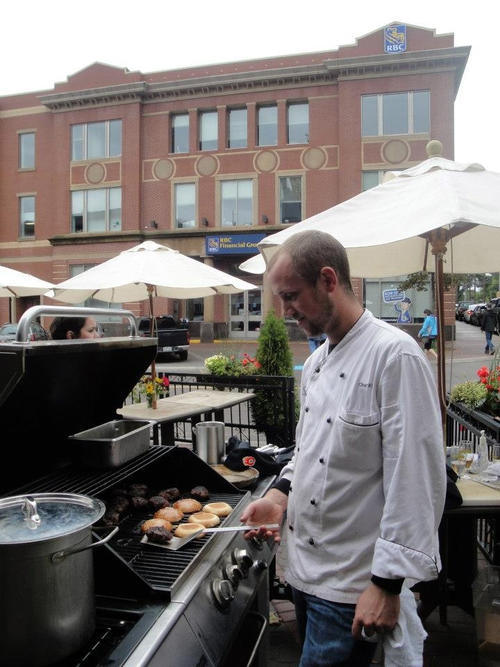 Chef Kyle from #Sims grilling up some #PEI #burgers at #Farm Day in the City! www.peiflavours.ca