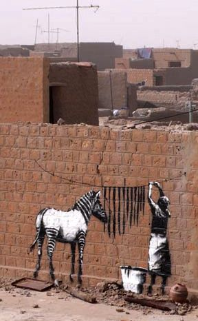 Banksy #street art #graffiti This art was also painted on 35th Street West in Lancaster, California sometime last year,2012. Beautifully done and I saw the artist and a girl working on it. City worker