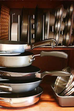 Use pan organizers both horizontally and vertically to maximize storage space in your kitchen cabinets. | 52 Meticulous Organizing Tips For The OCD Person In You